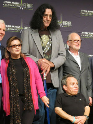The rather tall gentleman in this picture is Peter Mayhew, who wore the scorching hot Chewbecca outfit in the original 'Star Wars' trilogy. He slated to return in the next installment.