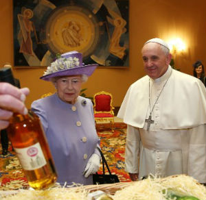 Pointing to the floor, Queen Elizabeth added that she also brought 'two extra bits which would not fit in the basket,' and which consisted of a bottle of whiskey and apple cider.