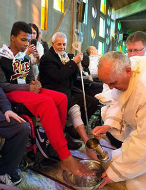 This year, Francis arrived at a center for the disabled and elderly in Rome. Francis kneeled down, washed, dried and kissed the feet of a dozen people, some in wheelchairs, other with grossly swollen and disfigured feet.