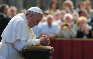 Pope Francis prays during a general audience in this file photo.