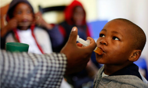 A boy is given a dose of medication in a South African clinic. Despite the progress of the past year, much more remains to be done. Doctors are hopeful however, the nation has turned a corner.