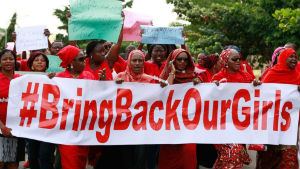 A group of Nigerians holding banners urging the Muslim group Boko Haram to return the more than 200 girls they kidnapped in mid-April.