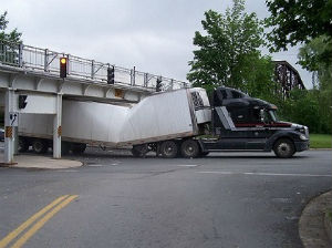 A long island trucker had the top of his semi's trailer sheered off after he hit an overpass that was lower than usual.
