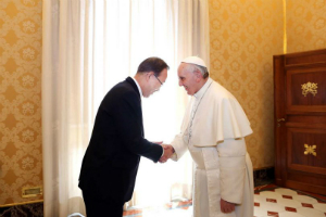 Pope Francis greets UN Secretary General Ban Ki-moon.