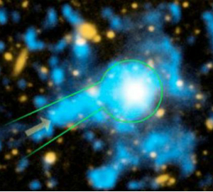 This image from Caltech shows a filament of gas streaming towards a quasar, which is a supermassive, energetic black hole at the center of a galaxy.