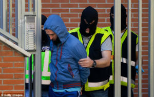 10 men were arrested by Spanish police, accused of working with jihadist groups.