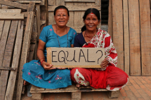 Women participate in a campaign to bring awareness to inequality in Nepal. This inequality manifests itself in some very real and painful ways.