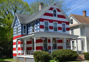 A father of seven foster children painted his house like an American flag after he received nine complains.