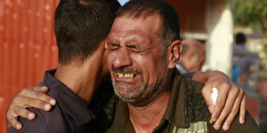 Christians in Mosul embrace one another as they are forced to leave absolutely everything behind at gunpoint.