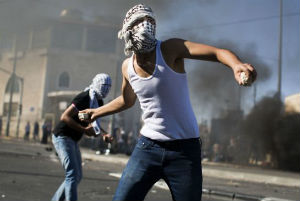 Parts of East Jerusalem have erupted in violence after the abduction and death of a teenage Palestinian.