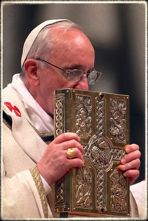 Pope Francis kissing the Book of the Gospels