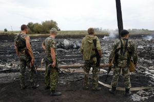 Russian backed separatists stand around wreckage from the downed Malaysian Airlines plane.