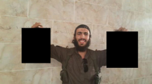 Mohamed Elomar poses with a pair of his victim's heads, taking delight in the slaughter of fellow Muslims.