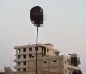 Soldier's heads were hoisted on poles as they were killed in Syria.