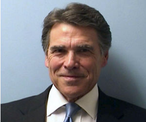 Under duress, Texas Governor Rick Perry maintained an upbeat and positive attitude. Arriving at the Travis County courthouse in Austin for booking and fingerprinting, Perry gave a warm smile for his mug shot.