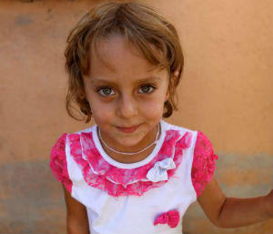 A child of the Yazidi minority group, noted for blonde hair, blue eyes and a fairer complexion.
