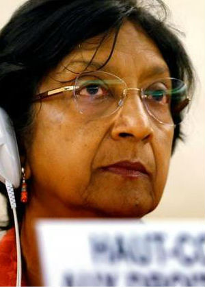 U.N. Human Rights Chief Navi Pillay condemned 'grave, horrific human rights violations' being committed by IS, a jihadist group that has seized large areas of Iraq and Syria.