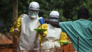 Aid workers in Sierra Leone distribute food to patients infected with Ebola.