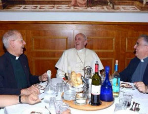 Pope Francis share a laugh with fellow Priests.