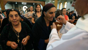 Iraqi Christians receive communion in the Kurdish city of Arbil. Sunday was the first time in 2,000 years no communion was offered in Nineveh, because no Christians remain.
