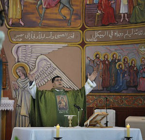 Father Hernandez and three Missionaries of Charity were the only religious left at Holy Family Church during a 50-day battle between Israeli forces and Hamas militants.