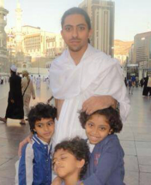 Raif Badawi stands with his children. His wife and kids fled to Canada after his arrest.