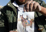 Image of A Yemeni man says the child, pictured riding a horse, was killed in the Saudi air stirke in Sana'a this week.