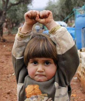 Four-year-old Syrian girl mistakes camera for gun and 'surrenders' in heartbreaking photo