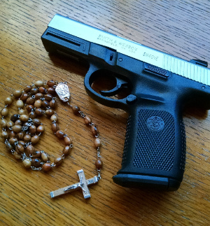 Catholic pastor warns parishioners faith is not enough for safety, encourages gun possession