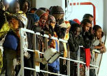 Image of More than 10,000 people have arrived on Italian shores from Libya since last weekend alone.