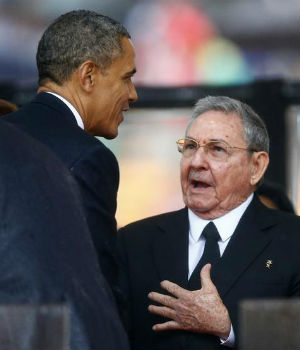 COLD WAR NO MORE? U.S. President Barack Obama and Cuban President Raul Castro meet