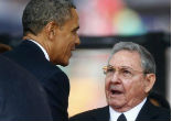 Image of Obama and Castro greeted each other courteously amid an explosion of camera flashes Friday night. The two sat at the same table but not directly next to one another.
