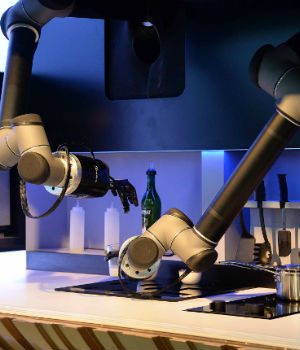 Robot arms cook up meals in kitchen at Asian electronics show