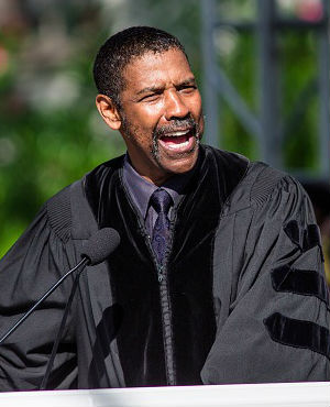 Denzel Washington urged graduates to 'fail big' and take chances. However, about material things, he cautioned, 'you will never see a U-Haul behind a hearse.'