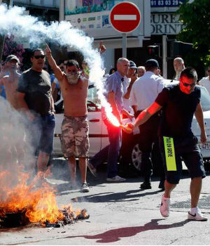 Riots and protests prompt the banning of the Uber taxi service in France