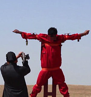 ISIS crucifies and dismembers prisoner in sickening video hitting new depths of depravity