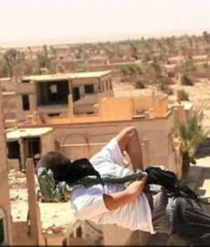 ISIS executes two homosexuals by pushing them off the roof (WARNING: Graphic Content)
