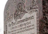 Image of A six-foot-tall granite monument of the Ten Commandments will be removed from the Oklahoma capitol in Oklahoma City. It was ruled that the monument violates the state's constitutional ban against the use of public funds or property to benefit a religion.