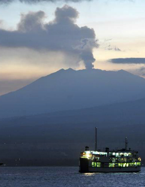 Indonesia's rumbling volcano causes flight cancellations and panic for tourists