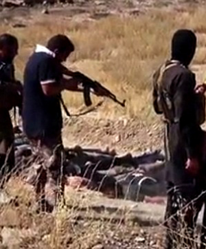 Images from ISIS' biggest massacre released showing child killing prisoners (WARNING: GRAPHIC IMAGES)