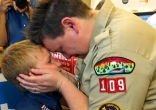 Image of Jennifer Tyrrell of Bridgeport, Ohio, a Cub Scout den leader who was kicked out in 2012 for being openly gay, embraces her son Cruz Burns.