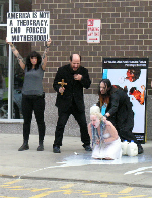 Satanists drench women in milk during Planned Parenthood counter-protest
