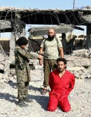 ISIS child fighter executes handcuffed prisoner as ISIS boasts new generation of fighters (WARNING: GRAPHIC CONTENT)