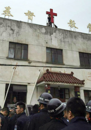 Seven Christians arrested in China following protests against government campaign to remove crosses from churches