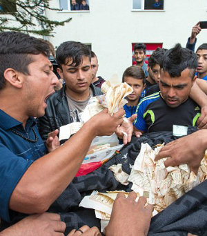 Afghan man rips up Koran sparking threatening riot in overcrowded German refugee camp