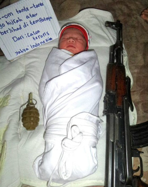 Disturbing photo of 'Jihadi baby' sleeping with weapons released as fear of Indonesian ISIS becomes real