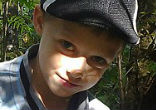 Image of Twelve-year-old Denis Alexandrov discovered the paw print while on an early morning walk with other children.