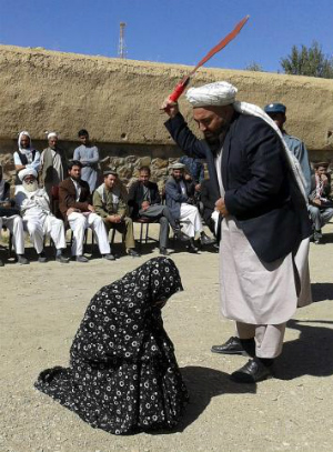 Crowd of men watch as Afghan woman receives 100 lashes for adultery