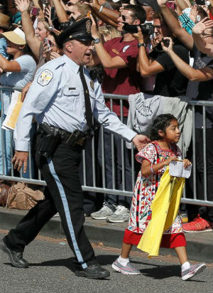 The story behind the little girl who ran to Pope Francis during the Papal Parade