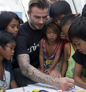 David Beckham's eyes water as he recalls one family's tragic loss during Typhoon Haiyan